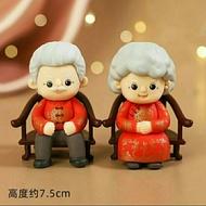 patung pajangan kakek nenek baju merah