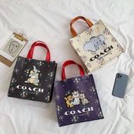 COACH  Fashion handbag กระเป๋าสะพาย กระเป๋าถือผ้า ลายการ์ตูน มาใหม่ สวยมาก