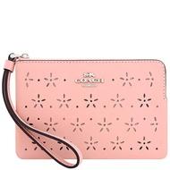 COACH 粉紅色鏤空雕花皮革手拿包