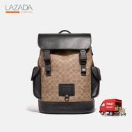 COACHกระเป๋า Rivington Backpack ผ้า Canvas เคลือบลายซิกเนเจอร์ สีครีม ของแท้