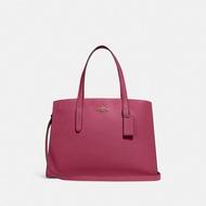COACH - กระเป๋ารุ่น Charlie Carryall สีชมพู