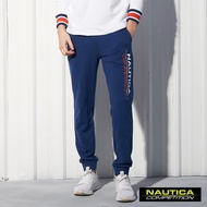 【NAUTICA】COMPETITION素面撞色LOGO運動長褲(藍色)