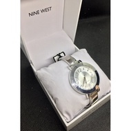 Nine West Women's NW/1631SVSB Silver-Tone Sunray Dial and Bangle Watch