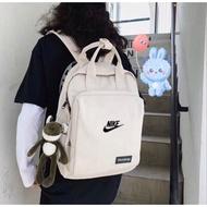 Laz Bag Nikeกระเป๋าเป้สะพายหลังnike2 ใหม่สีชมพูกระเป๋าถือหวานแว๋วกระเป๋านักเรียนนักศึกษาลมกระเป๋าสะพายเดินทางกระเป๋าคอมพิวเตอร์