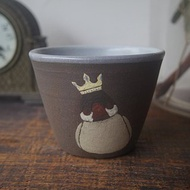 Handleless cup with Java sparrow