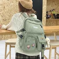 HOCODO Kawaii เป้นักเรียนหญิงนักเรียนกระเป๋านักเรียนน่ารัก Badge หลายกระเป๋ากระเป๋าเป้สะพายหลังไนลอนผู้หญิงแฟชั่นกระเป๋าเดินทาง Book