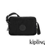 【KIPLING】極致低調黑前後加寬收納側背包-ABANU
