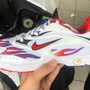 Supreme x nike zoom streak spectrum plus