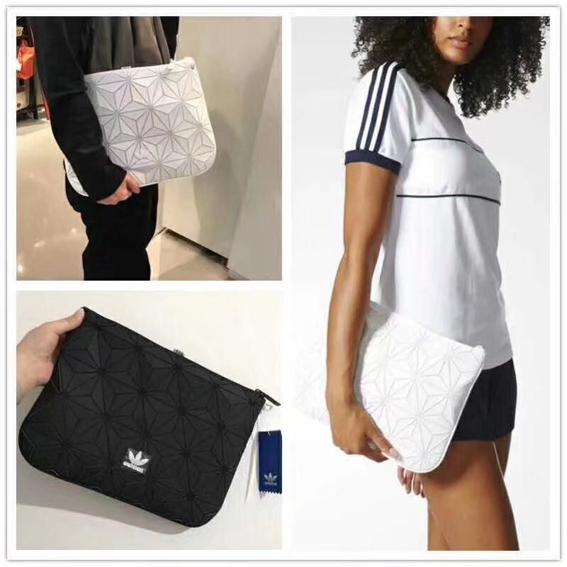 ee6b4741d47d 🔥In Stock🔥 Issey Miyake 3D Clutch Sleeve Adidas Hand bag Men s and women s